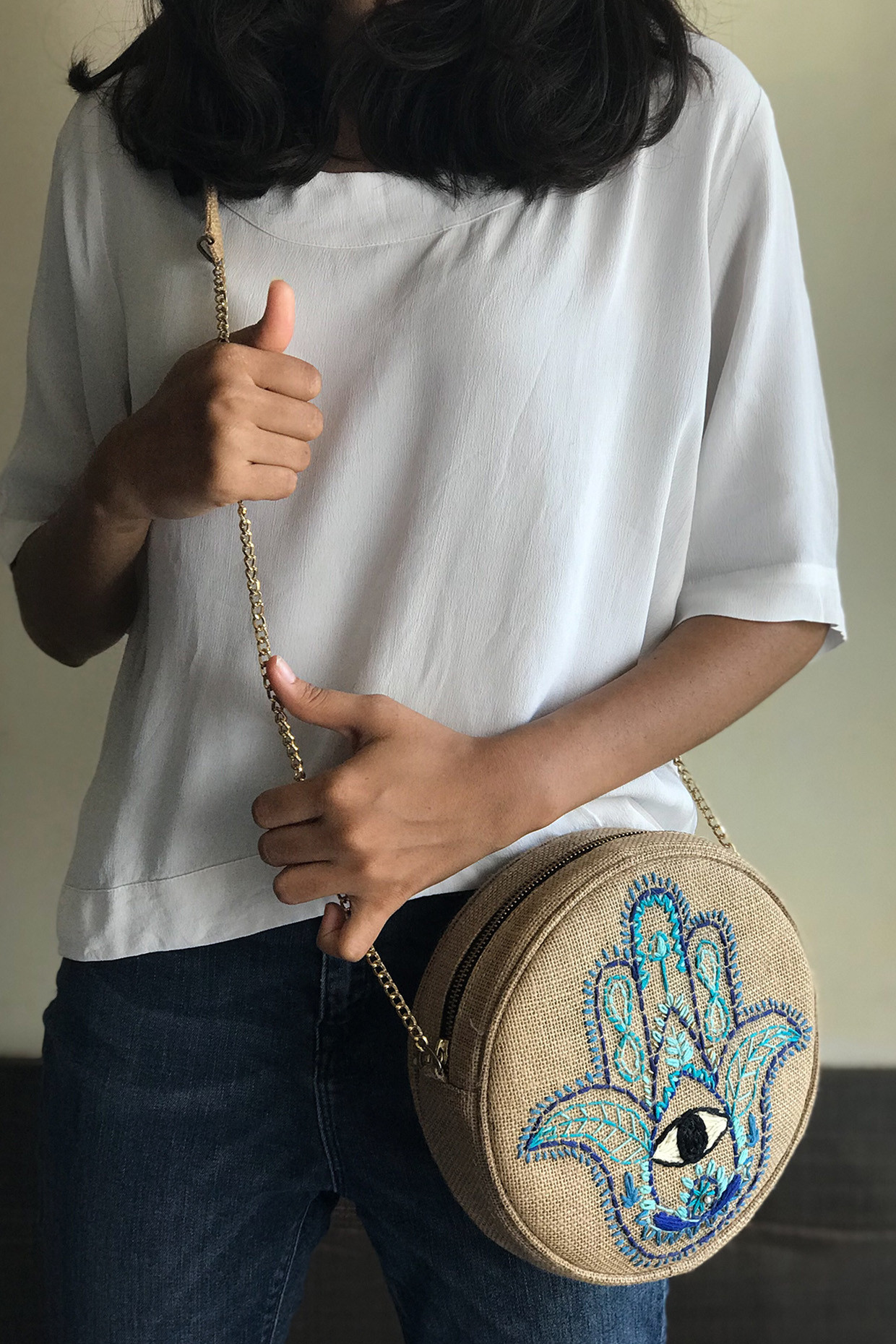 Handcrafted Jute Sling Bag With Embroidered Hamsa Hand by Dhaga Handicraft