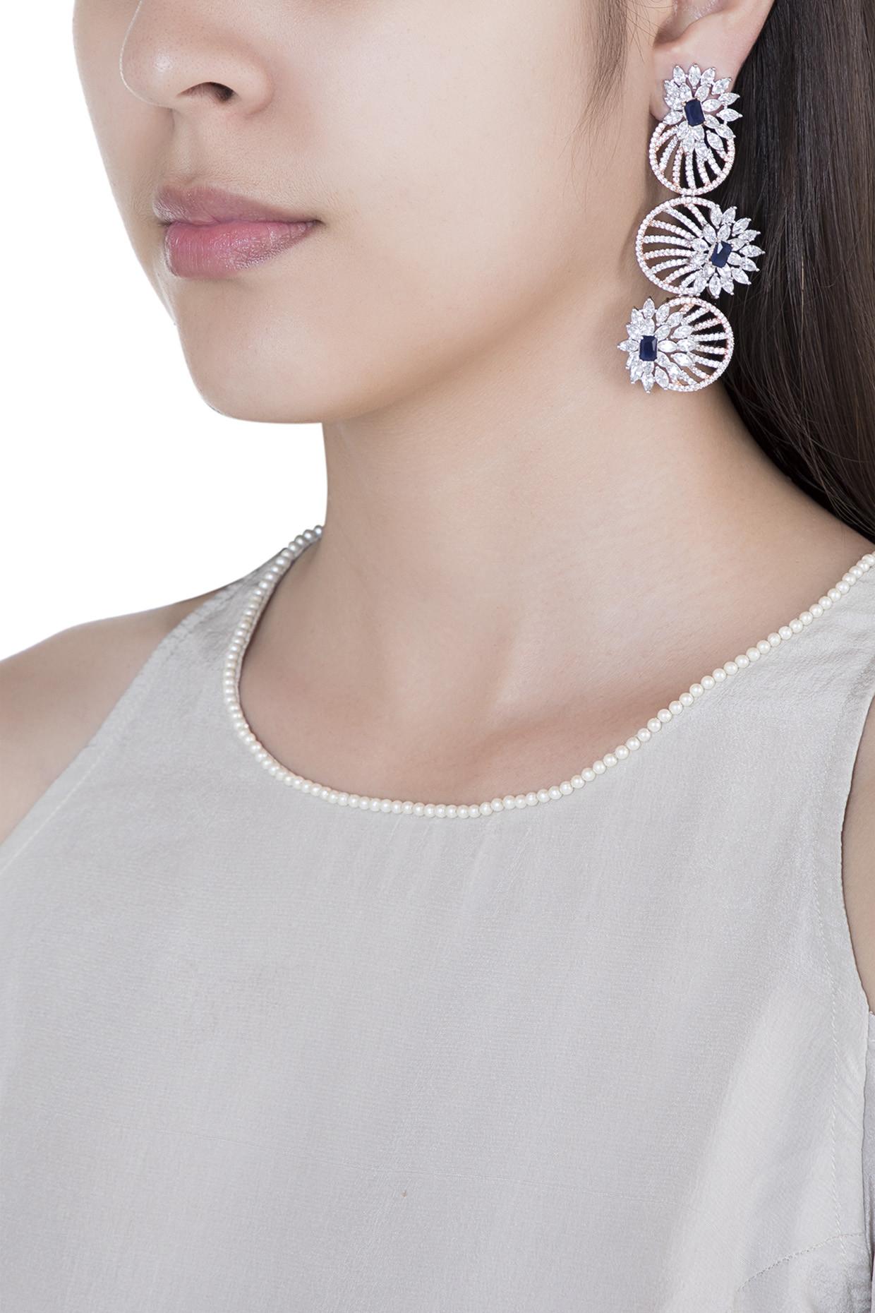 Silver plated faux diamond long dangler earrings by Aster